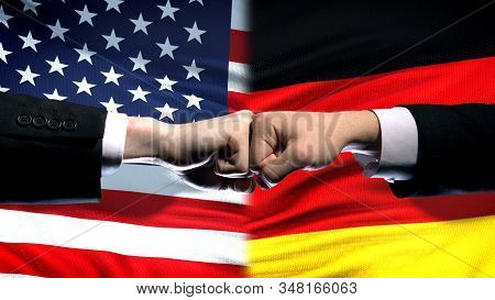 Us Vs Germany Conflict, International Relations Crisis, Fists On Flag Background