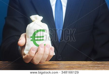 Man Holds Euro Money Bag. Granting Financing Business Project Or Education. Provision Cash Financial