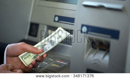 Male Getting Dollars From Automatic Teller Machine, Cash Withdrawing, Banking