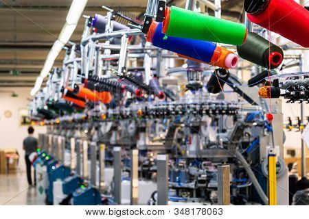 Colorful Reel Thread Set Up At Modern And Automatic Sewing Or Embroidery Spinning Machine, Textile I