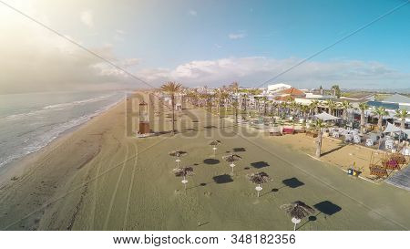 Drone Photo Of Larnaca Beach In Cyprus, Straw Parasols And Chaise-longues, Sea