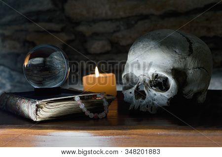 Occult Mystic Ritual Relics - Human Scull, Candle, Crystal Ball, Old Book And  Spider