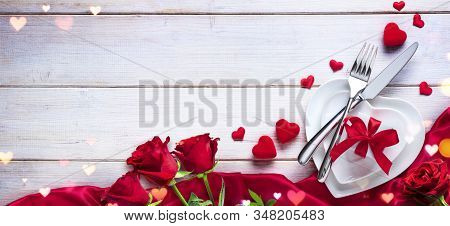 Valentines Day Dinner Romantic Table Setting With Gift And Roses