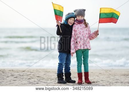 Adorable Little Brother And Sister Celebrating Lithuanian Independence Day Holding Tricolor Lithuani