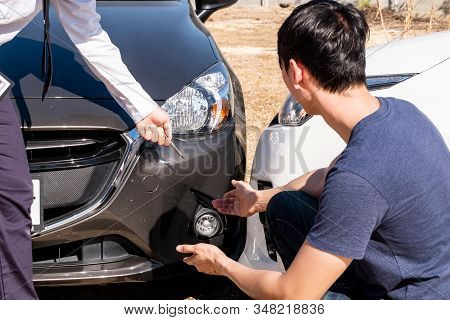 The Car Insurance Agent Is Checking The Accident Spot. Of The Customer, Along With The Form And Cust