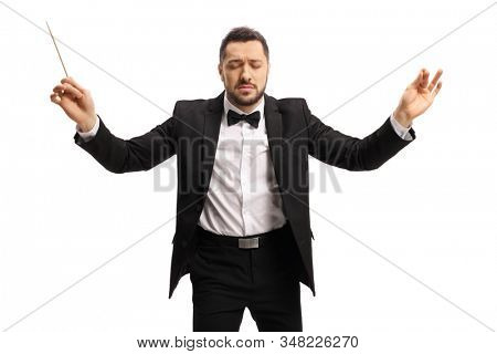Young male conductor with closed eyes conduction with baton isolated on white background