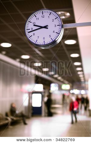 Clock over people