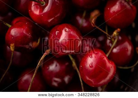 Ripe Cherries On A Black Background