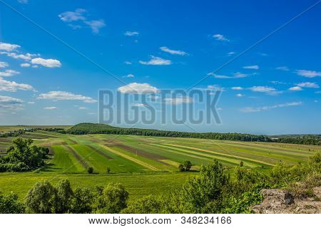 Green Spring Nature Landscape With Agrarian Agricultural Field Near Village Country Side Space