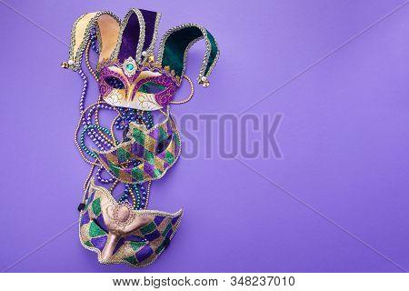 Festive Mardi Gras, Venetian Or Carnivale Mask On A Purple Background. Top View