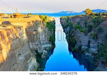 The Corinth Canal In The Morning Summer Day Illuminates The Bright Rising Sun Of Greece, A View Of T