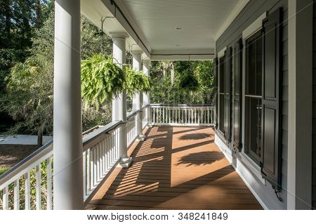 Wrap around porch on beautiful luxury home.