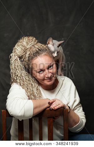 Mid Adult Woman And Her Pet Cat Portrait