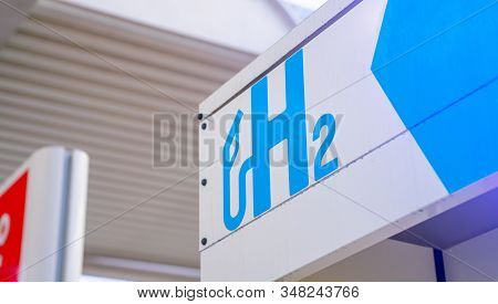 Hydrogen Logo On Gas Stations Fuel Dispenser. H2 Combustion Engine For Emission Free Ecofriendly Tra