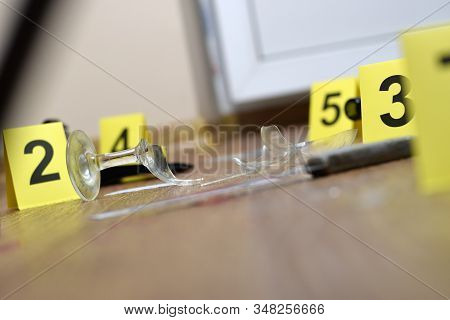 Crime Scene Investigation - Numbering Of Evidences After The Murder In The Apartment. Broken Glass O