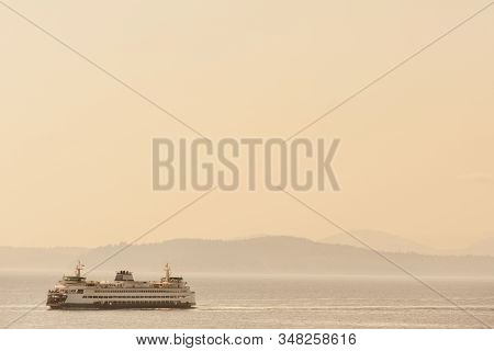 Ferry Boat Carrying Passengers And Cars Across Puget Sound From Seattle Towards Olympic Peninsula, W