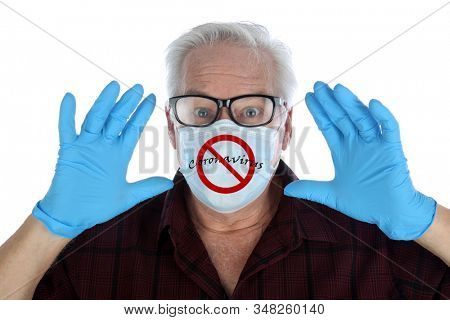 Coronavirus. 2019-nCoV. 2019 Novel Coronavirus. A man wears a paper face mask with the international NO symbol over the words Coronavirus. Coronavirus graphics behind patient. Be safe wear protection.