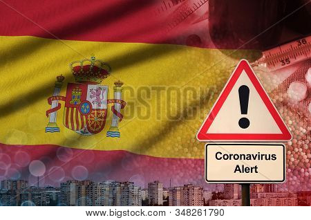 Spain Flag And Coronavirus 2019-ncov Alert Sign. Concept Of High Probability Of Novel Coronavirus Ou