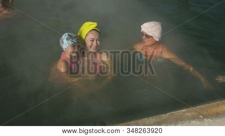 Baby Girl, Mom And Grandmother In A Swim In Hot Saline Mineral Water Bath At A Traditional Spa Outdo