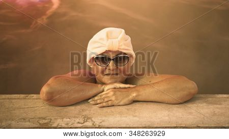 Close Up Caucasian Woman In A Swim In Hot Saline Mineral Water Bath At A Traditional Spa Outdoor Wit