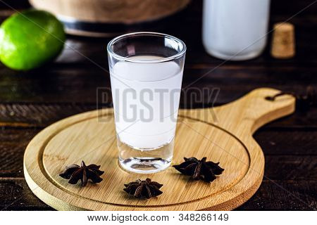 Distilled Drink,anise Base, On Wooden Background. Traditional Turkish And Greek Appetizer, Known As