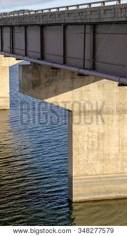 Vertical Frame Deck Of A Beam Bridge Supported By Abutments Or Piers Spanning Over Blue Water