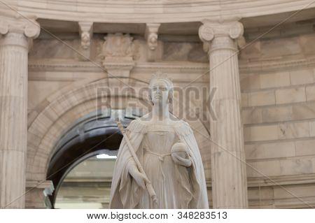 Queen Victoria Statue Inside Victoria Memorial In Kolkata. Majestic On A Marble Pedestal, Statue Scu