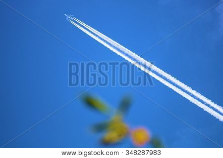 Well Defined Airplane Contrail In The Sky Representing A Saturated Upper Atmosphere Taken From The G