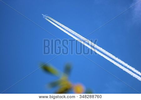Well Defined Airplane Contrail Because Of A Saturated Upper Atmosphere Taken From The Ground