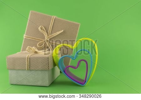 Romantic Still Life With Decorative Gifts And Colorful Heart Shapes On Green With Copy Space For A M