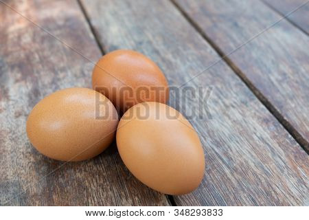 Close Up Eggs On Wood Texture For Cook.