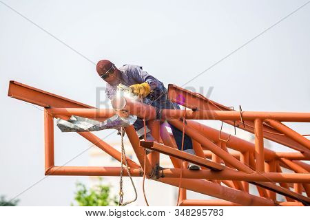 The Welding Workers At Structures Site. Worker Is Welding Steel Structures.