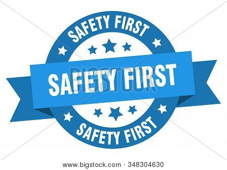 Safety First Ribbon. Safety First Round Blue Sign. Safety First