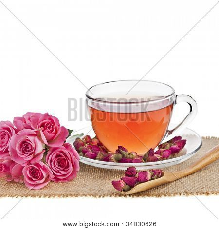Tea Glass Cup with Fresh Rose flower isolated on white