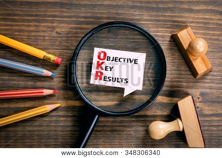 Objective Key Results. Magnifying Glass On Wooden Table