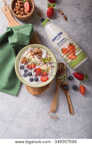 Kyiv, Ukraine - Jenuary 05, 2020: Danone Yogurt Botl. Smoothie Probiotic Or Smoothy Bowl With Granol