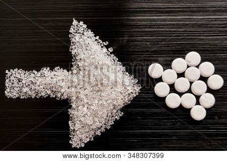 Sweetener Tablets Lying With Sugar On A Dark Background