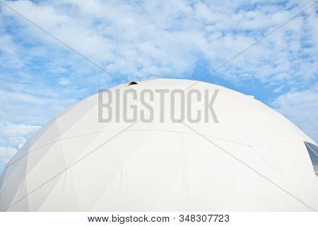 Geodesic Dome On A Background Of Blue Sky