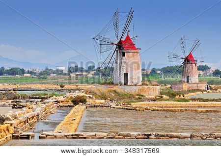 Windmills And The Oldest Europe's Salt Ponds In Sicily Italy Between Marsala And Trapani.