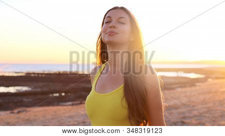 Total Relax. Free Happy Woman Enjoying Breathing At Sunset On The Beach. Young Woman Relaxing In Sum
