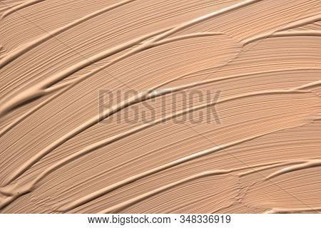 Abstract Background With Brush Strokes. Beige Facial Foundation Cream Close Up Texture. Nude Paint S