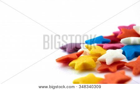 Colorful Bright Background, Multi-colored Stars. Sweet Nice Background Candy. Macro Shoot Photo