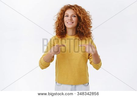 Proud, Attractive Lucky Redhead Curly Girl In Yellow Sweater, Got Promoted, Pointing Herself, Smilin