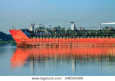 Large Metal Transport Ship Bulk Carrier. A Barge Sailing With A Cargo Of Containers From The Port Al