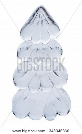 Abstract Christmas Tree Cut Out Of Ice Isolated On White