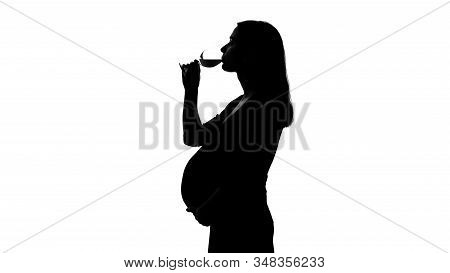 Silhouette Of Young Pregnant Woman Drinking Wine, Unhealthy Habits Harm Baby