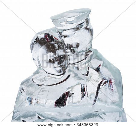 Ice Sculpture Of Cuddling Man And Woman Isolated On White
