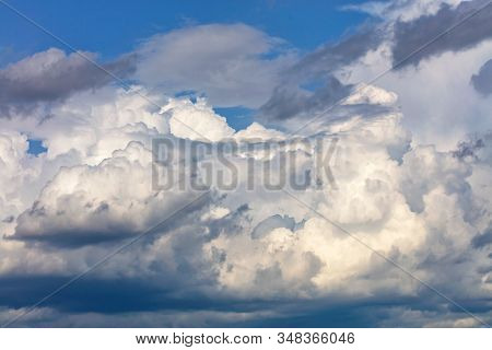 White-gray Cumulus Clouds Gradually Gather Together Into One Continuous Cover In Anticipation Of Rai