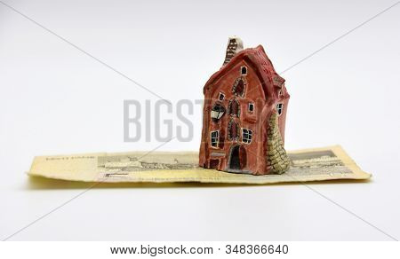 A Small House Stands On A Disused Estonian Five-kroner Banknote.