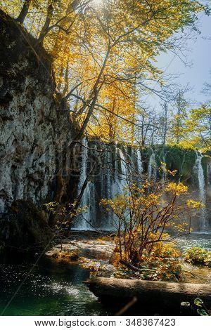 Beautiful Waterfalls Of Croatian National Park Plitvicka Lakes With Sun Shining Through The Trees.